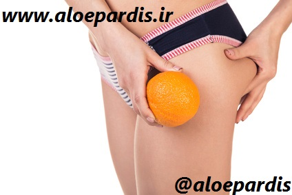 Beautiful slim and supple female buttocks with orange. Isolated on white.